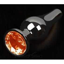 Графитовая удлиненная анальная пробка с оранжевым кристаллом - 12 см.