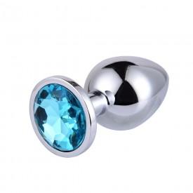 Большая серебристая анальная пробка с голубым кристаллом - 9,5 см.